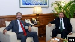 Indian Foreign Secretary S. Jaishankar, left, meets with Pakistani Foreign Secretary Aizaz Ahmad Chaudhry prior to a meeting in New Delhi, on April 26.