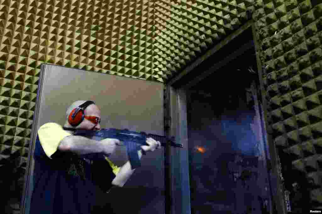 A weapons tester fires a prototype assault rifle at the shooting range.