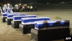 The coffins of five Israelis who were killed during the terror attack on a tour bus in Burgas, Bulgaria, resting at Ben Gurion International Airport near Tel Aviv on July 20.
