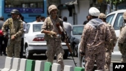 Members of the Iranian Revolutionary Guard secure the area outside the Iranian parliament after militants launched a deadly attack on the complex in Tehran on June 7.