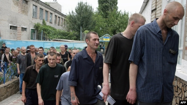 Tubercular patients at a penal colony in the Ukrainian village of Zhdanovka, in the Donetsk region, line up to enter the canteen.