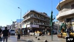 Pamje pas një eksplodimi të mëparshëm në Sheshin e Aviacionit në Bagdad