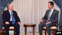 Syria -- Syrian President Bashar al-Assad (R) meets with Armenian Foreign Minister Edward Nalbandian in Damascus, May 27, 2015