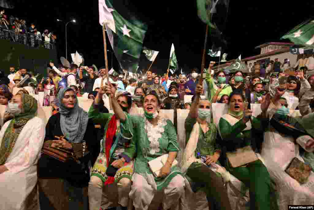 People cheer as they watch the Independence Day fireworks in Karachi.