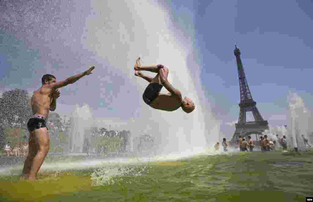 A man backflips into a pond at the Place du Trocadero in front of the Eiffel Tower in Paris on July 22.