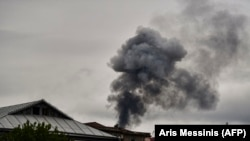 Последствия обстрела домов в Степанакерте/Ханкенди, городе в Нагорном Карабахе. 7 октября 2020 года.