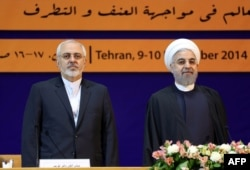 Iranian President Hassan Rohani (right) and Foreign Minister Mohammad Javad Zarif in Tehran in December 2014