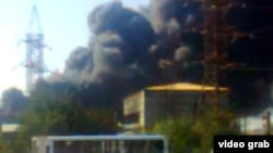 Smoke rises from a plant in the city of Sumgayit after at least two explosions.