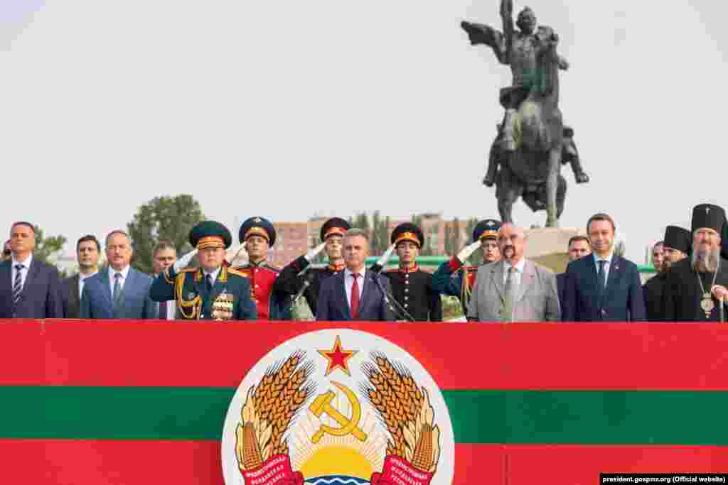 Separatist leader Vadim Krasnoselsky (center) and the first leader of the breakaway region, Igor Smirnov (third from right), attend a military parade on September 2, 2019. Smirnov lost an election in 2011 to Yevgeny Shevchuk, whom Krasnoselsky defeated in a 2016 vote.