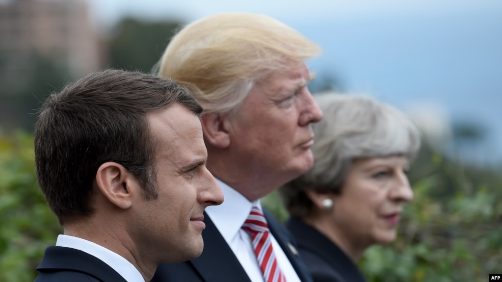 French President Emmanuel Macron, U.S. President Donald Trump, and British Prime Minister Theresa May (left to right) at the G7 summit in Sicily on May 26.
