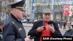 Belarusian journalist Syarhey Hardzievich (right) was also ordered to pay a $1,600 fine. (file photo)