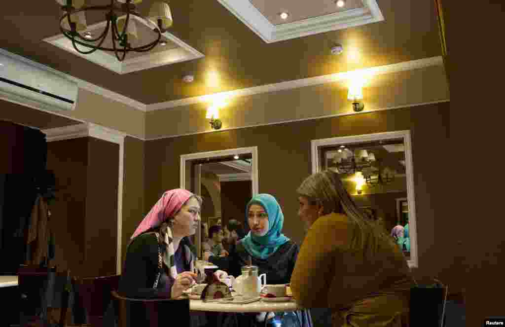 Women chat at a cafe in Grozny.