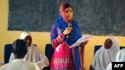 Pakistani activist for female education and the youngest-ever Nobel Prize laureate Malala Yousafzai addresses young refugees at Kenya's sprawling Dadaab refugee complex during a visit in July.