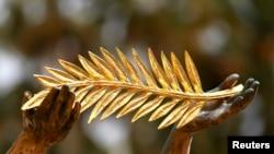 Zlatna palma, ilustrovana fotografija