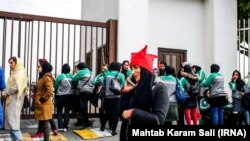 Iranian women waiting behind the gates before a Perspolis match in Azadi Stadium, to try to gain entry on November 10, 2018.