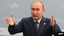 President Vladimir Putin gestures as he speaks at a meeting with G20 leaders St. Petersburg.