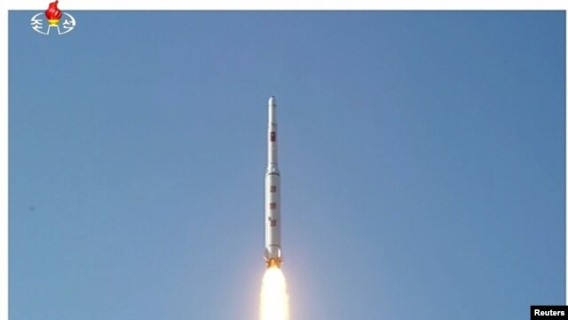 A North Korean long-range rocket is launched into the air in this still image taken from North Korean television on February 7.