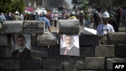 Supporters of the Muslim Brotherhood rallied on July 5 in support of ousted Egyptian President Muhammad Morsi.