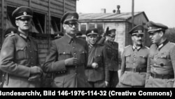 General Vlasov (second from left) poses with members of the ROA army in 1944, just south of Berlin.