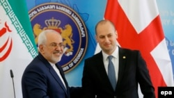Georgian Foreign Minister Mikheil Janelidze (right) welcomes his Iranian counterpart Mohammad Javad Zarif in Tbilisi.