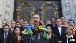 Georgian opposition politicians make a public statement in Tbilisi on March 27, indicating their intentions to have peaceful protests to call for Saakashvili's ouster.