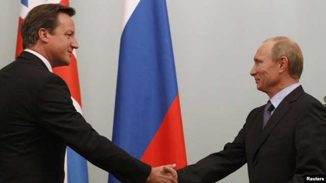 Russian President Vladimir Putin (right) is expected to hold talks with British Prime Minister David Cameron. (file photo)