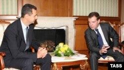 Президент Сирии Башар Асад и его российский коллега Дмитрий Медведев