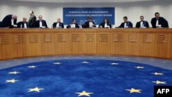 France -- Judges of the European Court of Human Rights (ECHR) get ready for a hearing in Strasbourg, October 14, 2014.