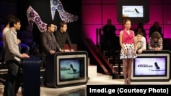 "The host and male contestants gang up on seemingly suspecting women respondents in Georgian Imedi TV's new game show ""Women's Logic."""