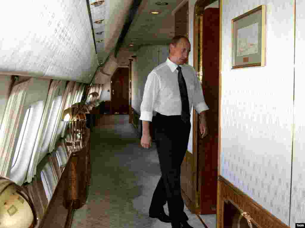 Putin on board one of his presidential planes. According to the report, he has 43 airplanes at his disposal.