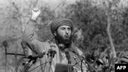 FILE: Gulbuddin Hekmatyar addresses a crowd of Afghan mujahedeen who gathered 17 January 1987 in Peshawar Pakistan.