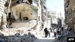 Սիրիա - Ռմբակոծությունների հետևանքով ավերված շենքեր Հալեպի արվարձաններից մեկում, արխիվ