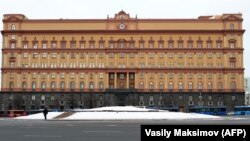 A man walks past the headquarters of the Federal Security Service (FSB), the successor to the KGB, in central Moscow.