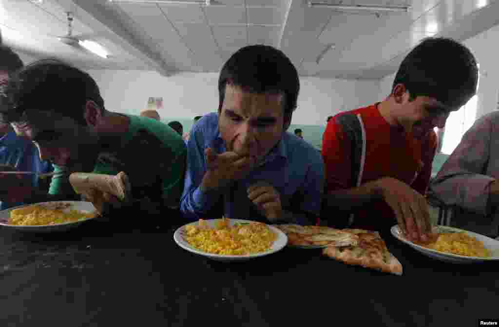 Blind students eat their meals at the Kabul Blind School.