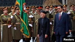 FILE: Afghan President Ashraf Ghani (2nd R) inspects the honor guards during a ceremony to introduce his new cabinet to the parliament in Kabul in January 2015.