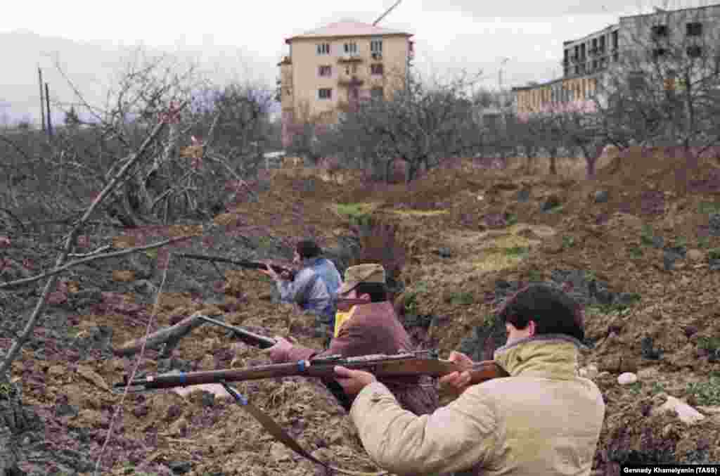 Ossetians in trenches on the outskirts of Tskhinvali. The men are using antiquated Russian Mosin-Nagant rifles first produced in the 1890s.   Throughout 1991 the patchwork of Georgian and Ossetian villages that made up South Ossetia was riven with interethnic murders and intimidation.