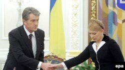 Ukraine's constitutional wrangling has turned President Viktor Yushchenko (left) and Prime Minister Yulia Tymoshenko from Orange allies into bitter rivals.