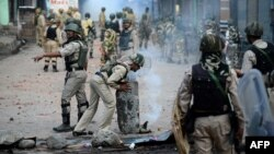 Indian security forces clear road blockades following clashes with Kashmiri protestors in Srinagar, Kashmir, in August.