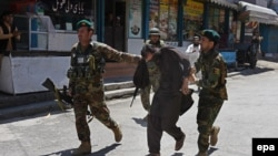 Afghan Army soldiers captured a suspected militant after several armed militants attacked a TV station in the eastern city of Jalalabad on May 17.