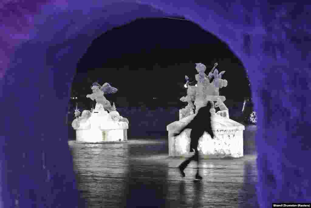 A skater glides past ice sculptures during an ice and snow sculpture festival near Almaty, Kazakhstan, on January 14.