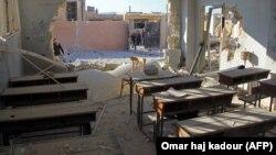 Разрушенная школа в городе Хас