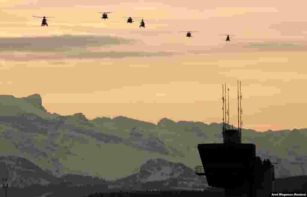 Helicopters approach before the arrival of U.S. President Donald Trump at Zurich airport on January 25. Trump was on his way to attend the Davos World Economic Forum. (Reuters/Arnd Wiegmann)