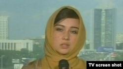 Сестра одного из заложников обратилась к похитителям по каналу «Аль-Джазира» с просьбой освободить заложников во имя ислама. Кадр НТВ