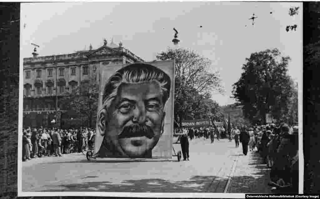 Soviet leader Josef Stalin's portrait being wheeled through central Vienna in 1952. From the end of World War II up until mid-1955, Vienna was divided into zones of occupation by the victorious Allies.