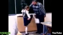An image from the viral video purporting to show a schoolgirl kicking an abusive teacher