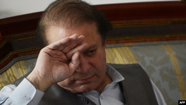 Incoming Pakistani Prime Minister Nawaz Sharif wipes his brow during a meeting with journalists at his house on the outskirts of Lahore on May 13.