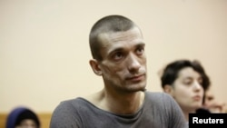 Russia – Artist Pyotr Pavlensky listens during a hearing at a courthouse in St.Petersburg, February 24, 2014