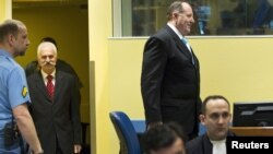 Former high ranking Bosnian Serb officials Mico Stanisic (right) and Stojan Zupljanin (left) arrive at the courtroom to attend trial at the International Criminal Tribunal for the former Yugoslavia in The Hague on March 27.