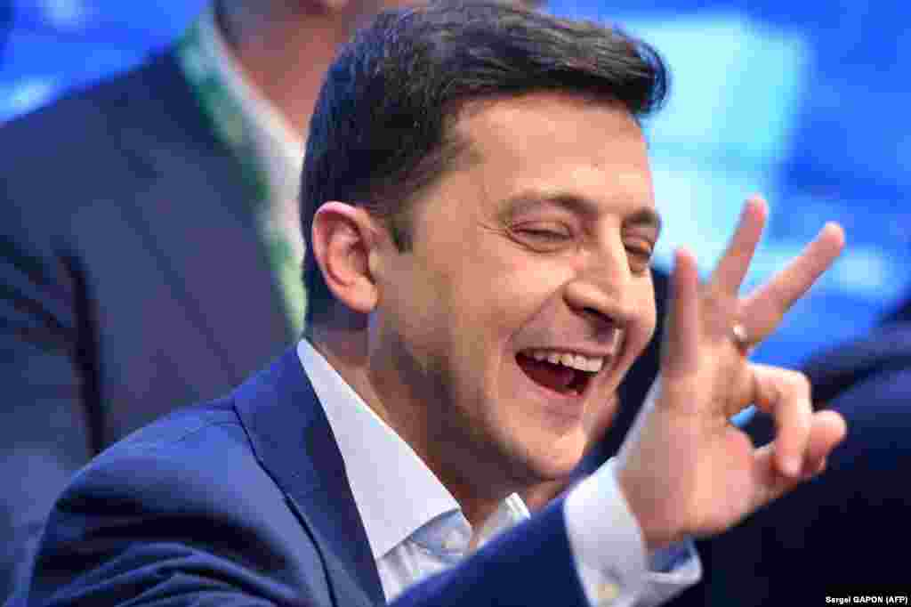 UKRAINE -- Ukrainian comedian and presidential candidate Volodymyr Zelensky reacts after the announcement of the first exit poll results in the second round of Ukraine's presidential election at his campaign headquarters in Kyiv on April 21, 2019.