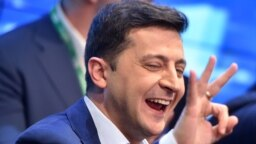 Volodymyr Zelensky reacts after the announcement of the first exit poll results in the second round of Ukraine's presidential election at his campaign headquarters.
